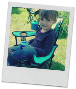 Toddler sitting in camping chair.
